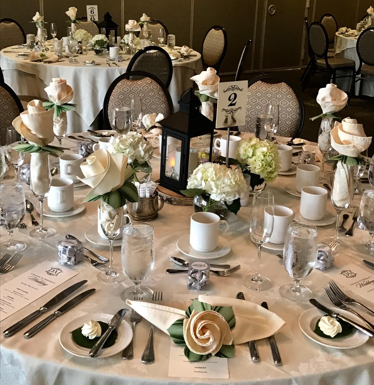 carole-shiber-botanic-wedding-rings-w-napkins.jpeg